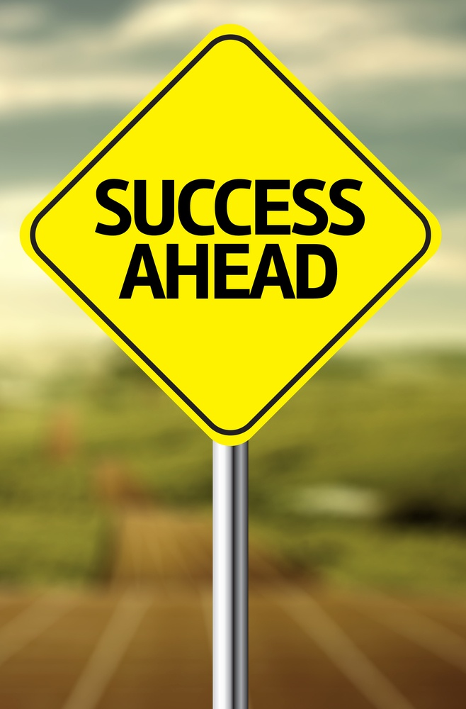 Creative sign with the message - Success Ahead