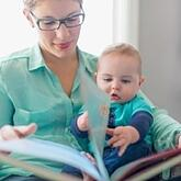 Cute baby reading with his mother-445180-edited-129917-edited