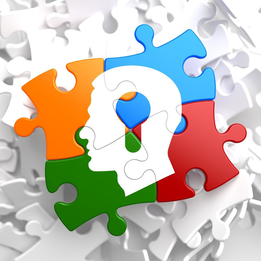 Psychological Concept - Profile of Head with a Keyhole Located on Multicolor Puzzle.-2.jpeg