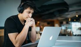man with laptop earphones