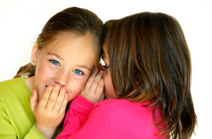 Auditory processing:Young girl whispering to another